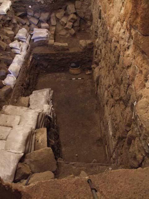 3. Thick Ottoman plaster floor and ceramic vessels in situ, looking north.