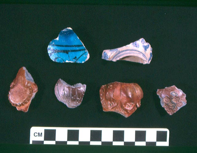 3. Potsherds and pipes from the bedding of the two street levels.