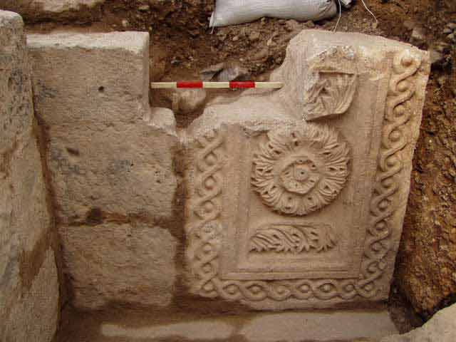 4. Fragment of a decorated lintel to the left, the wall blocking the gateway area.