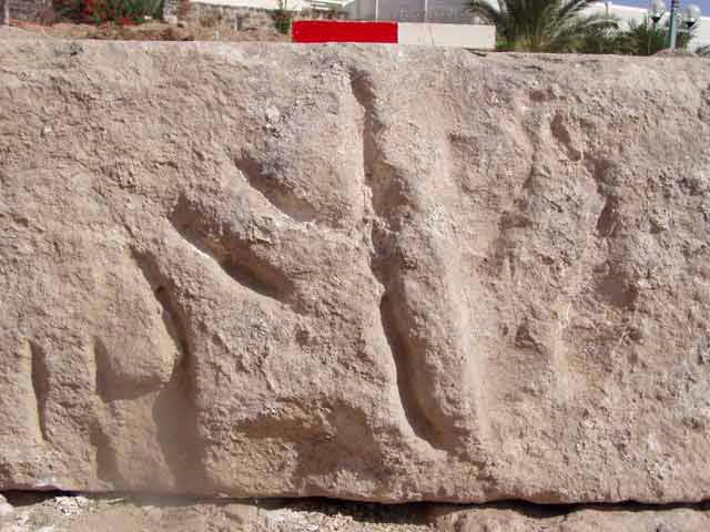 6. Basalt ashlar decorated with a relief of a menorah (?)