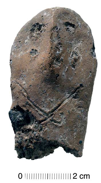 8. Area SA-M, an anthropomorphic andiron upright, of Khirbet Kerak type.