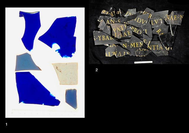13. Fragments of inscribed black marble slab and blue glass.