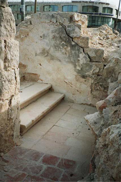 7. Staircase to second story, looking west.