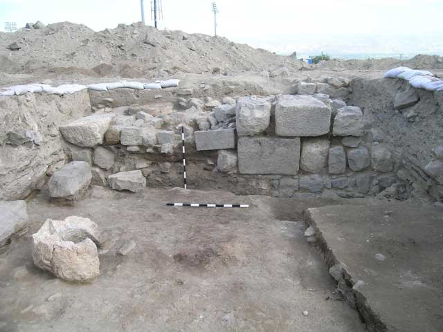 13. Area B, Stratum II, Wall 148, looking east.