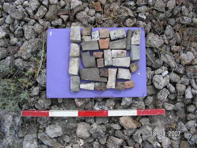 2. Site 287, tesserae, cubes of roof tiles and production fragments of basalt vessels.