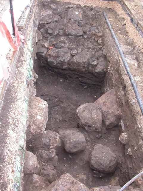 6. Square A, stone collapse and a burnt layer, looking north.
