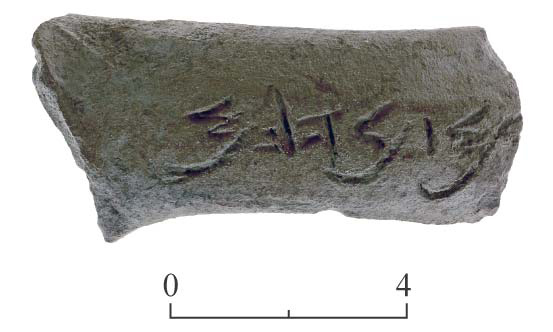 11. Jar handle engraved with an inscription.