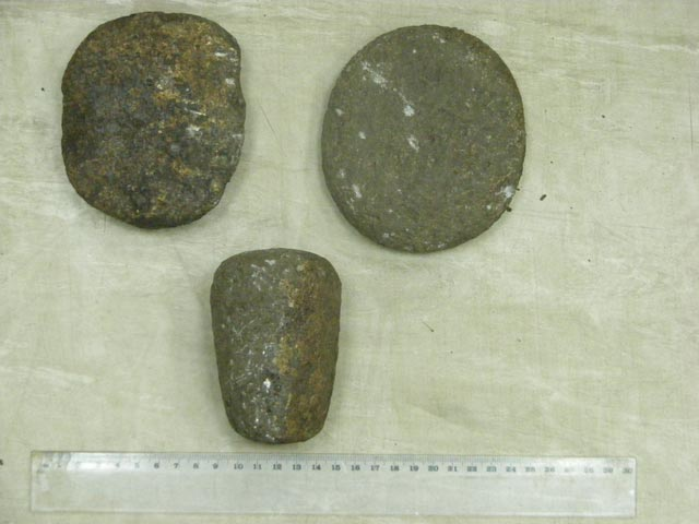 5. Area A, pestle and two hand stones from the burial.