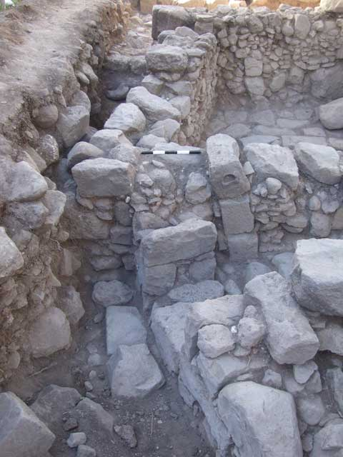 13. Wall 121 in foreground, showing blocking of original entrance in W111, looking south.