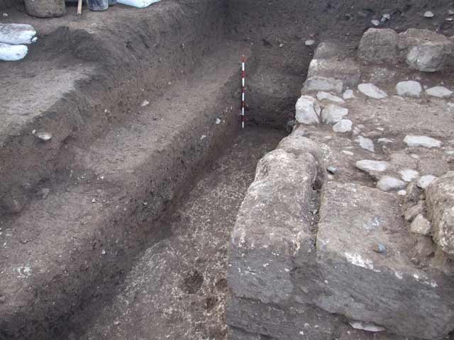 7. Stratum III, a floor bed (L18) east of Wall 15, looking south.